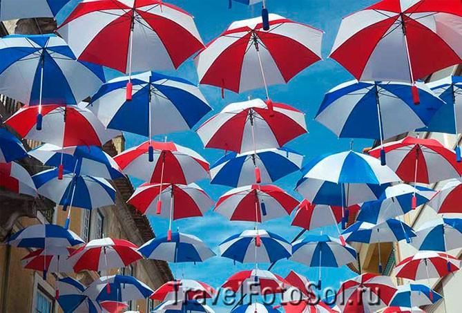 Цветные зонтики и живые статуи, Португалия
